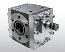 The polymer extruded through the gear pump